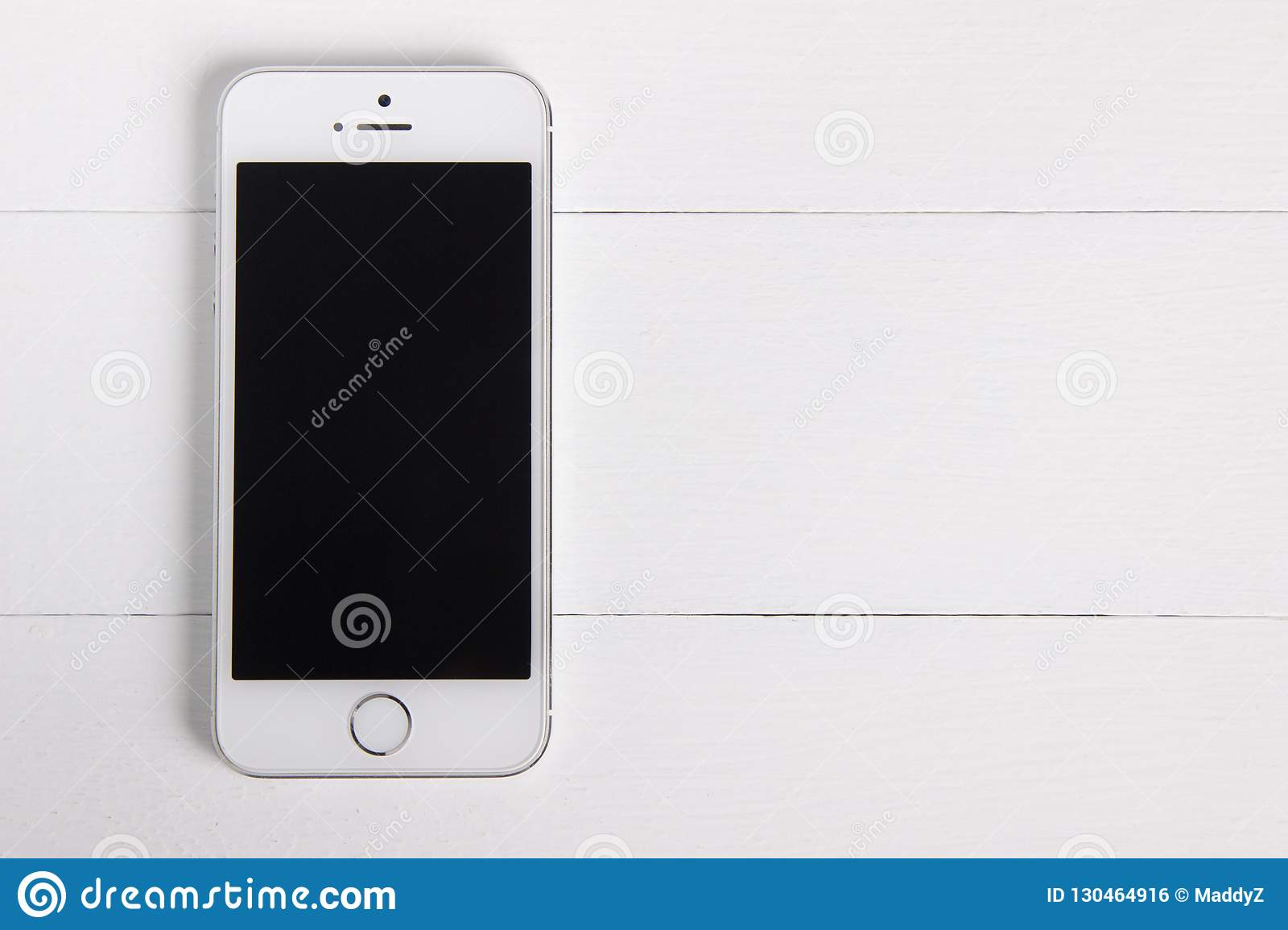 Moscow, Russia - November 1, 2018: Flat lay, front view of a silver white iPhone 5s. Product mock-up for ui, ux design