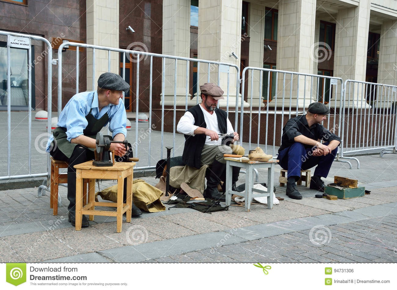 Moscow, Russia, June, 12, 2017, Participants of the festival `Times and epochs` on Manezhnaya square, the cobbler and shoe shiner