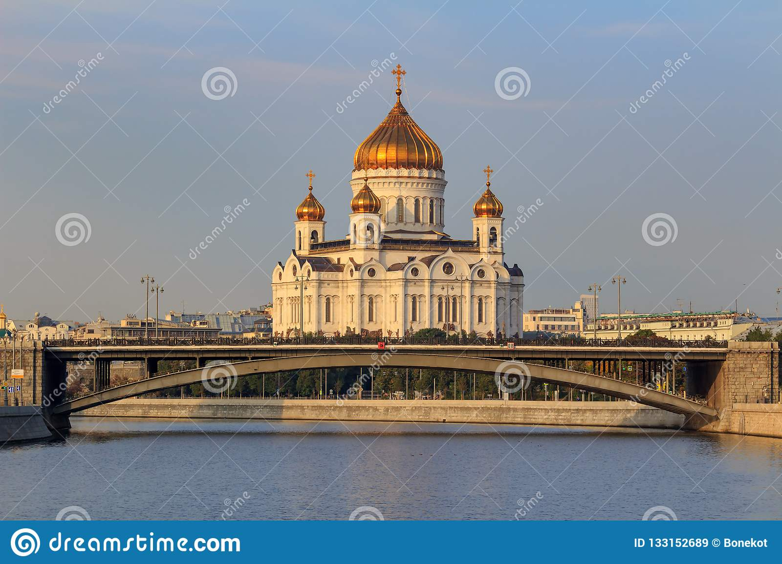 Moscow, Russia - September 02, 2018: Cathedral of Christ the Saviour in Moscow against Moskva river and Bolshoy Kamennyi Bridge in