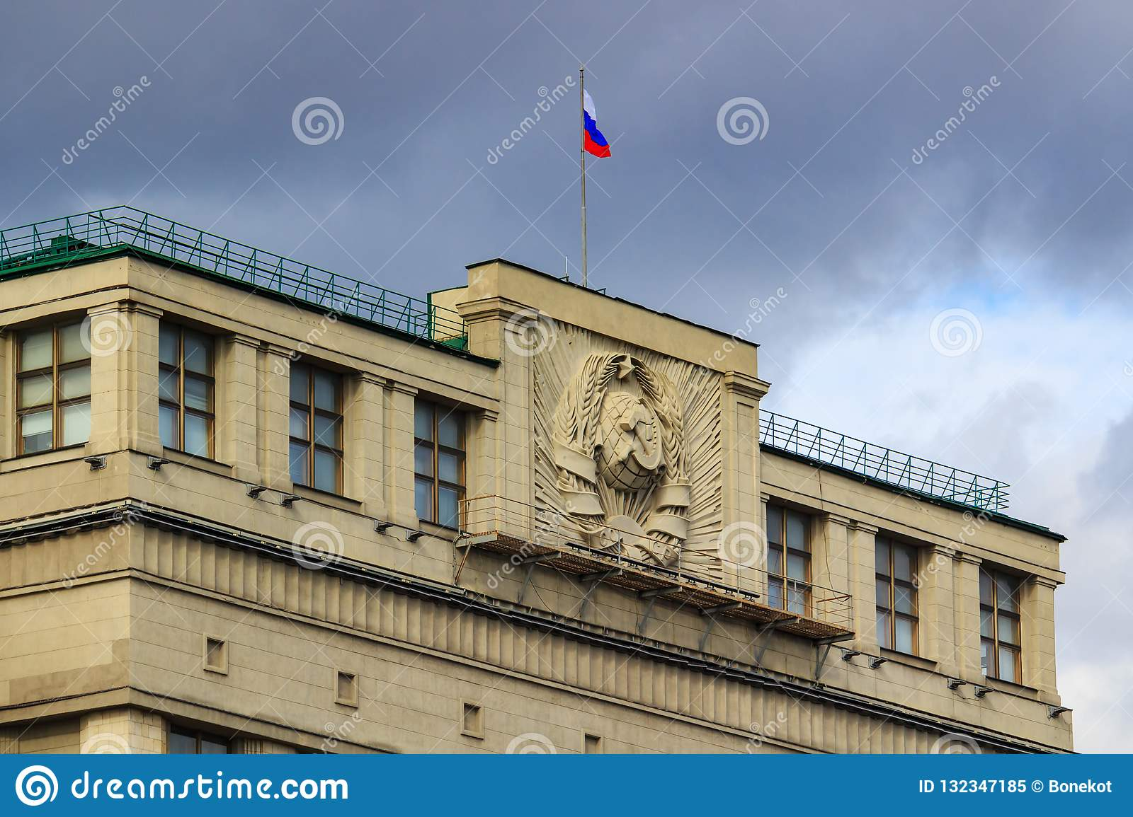 Moscow, Russia - September 30, 2018: Fragment roof of State Duma of Russian Federation closeup with waving Russian flag on a