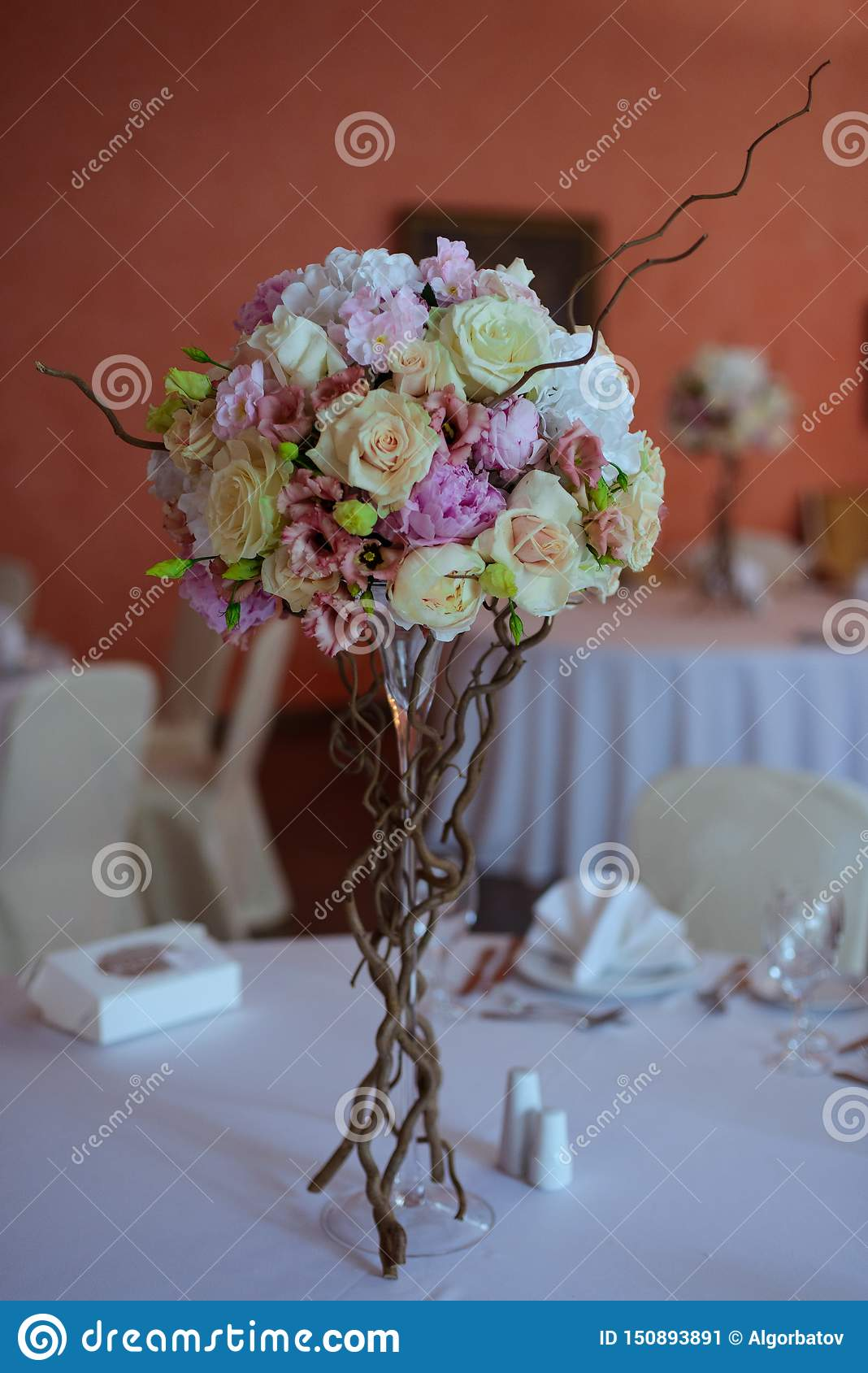 Bouquet of flowers on a leg in the interior of the restaurant for a celebration shop floristry or wedding salon