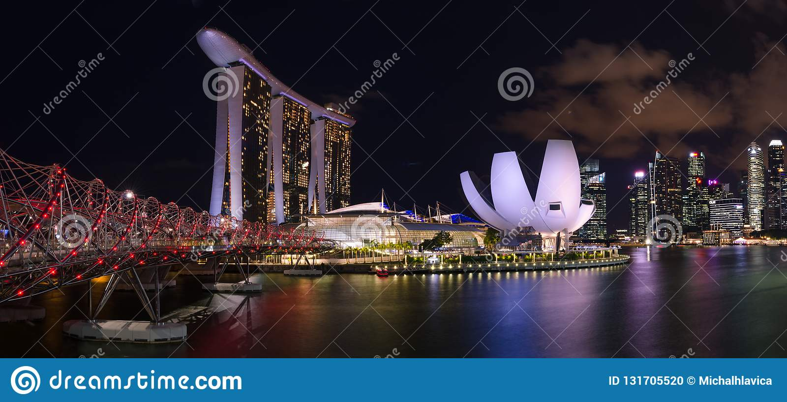 night panorama of Marina Bay Sands hotel and Art Science Museum in Singapore