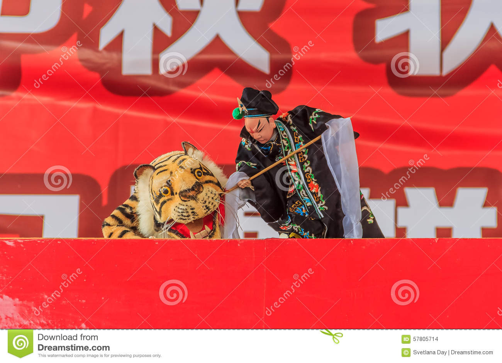 Mostra de fantoche chinesa da mão