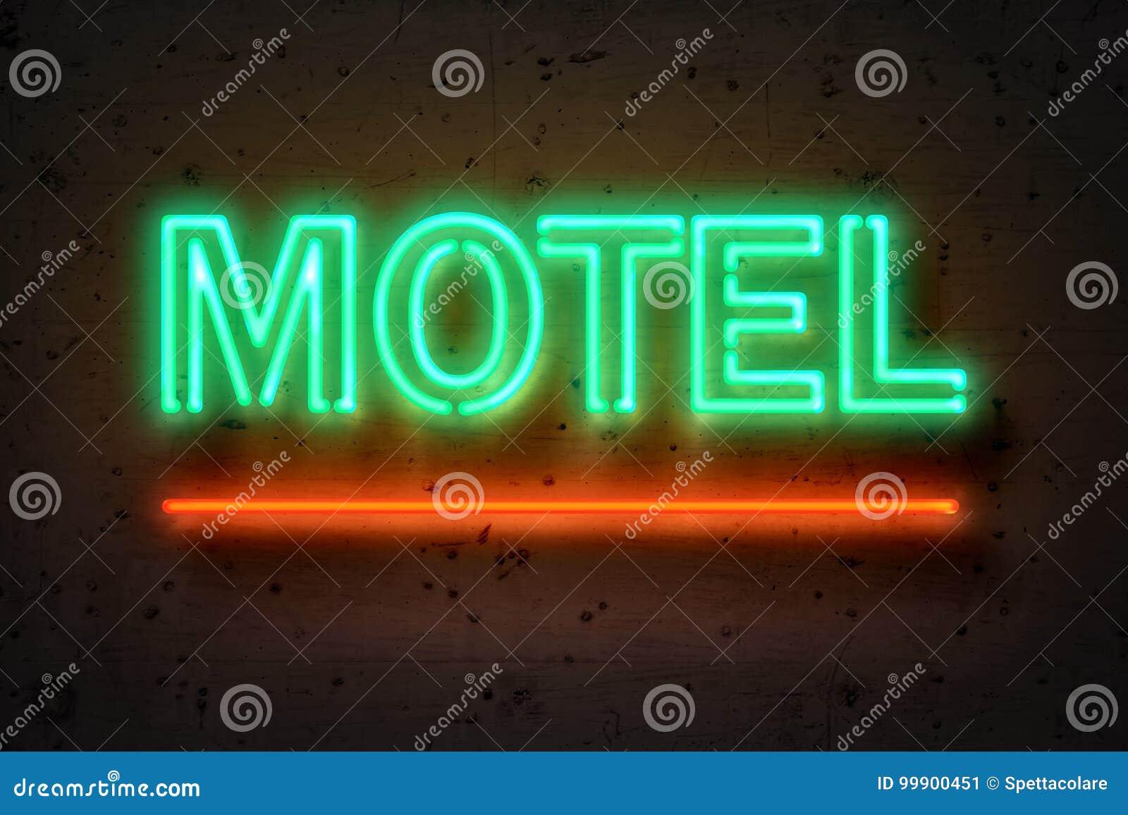 Motel, señal de neón en el muro de cemento
