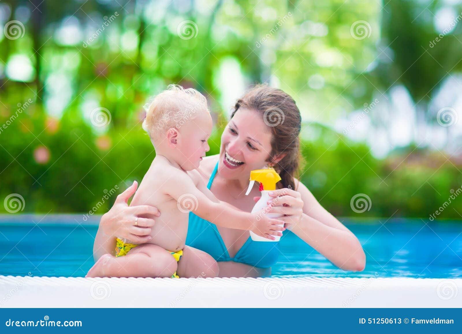 Boy enjoying summer vacation in a tropical resort at a swimming pool