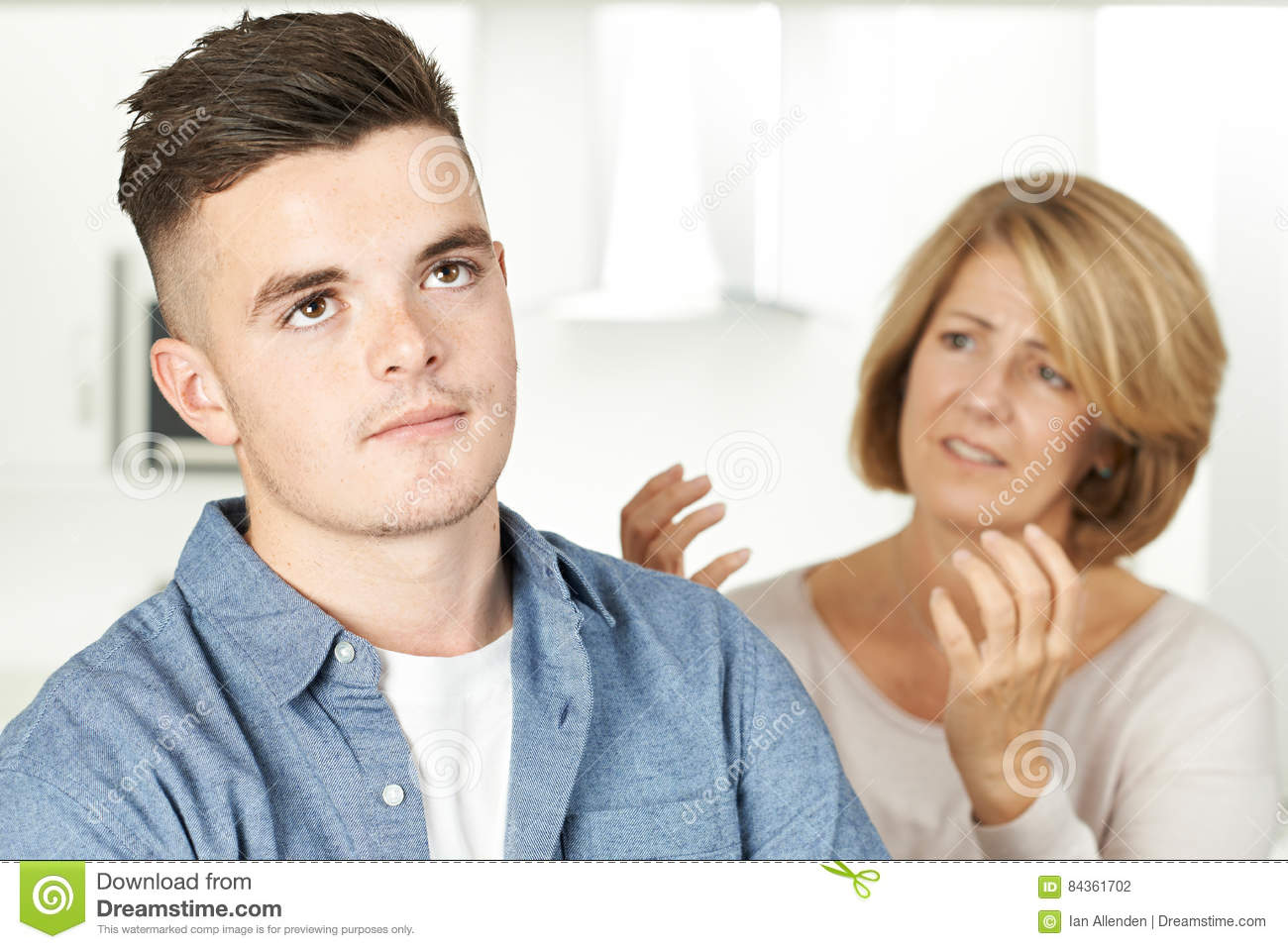 mother arguing with teenage son stock photo image 84361702. Black Bedroom Furniture Sets. Home Design Ideas