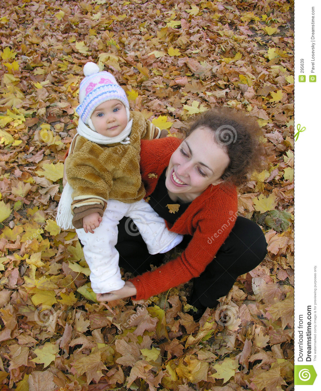 Mother with baby on autumn field