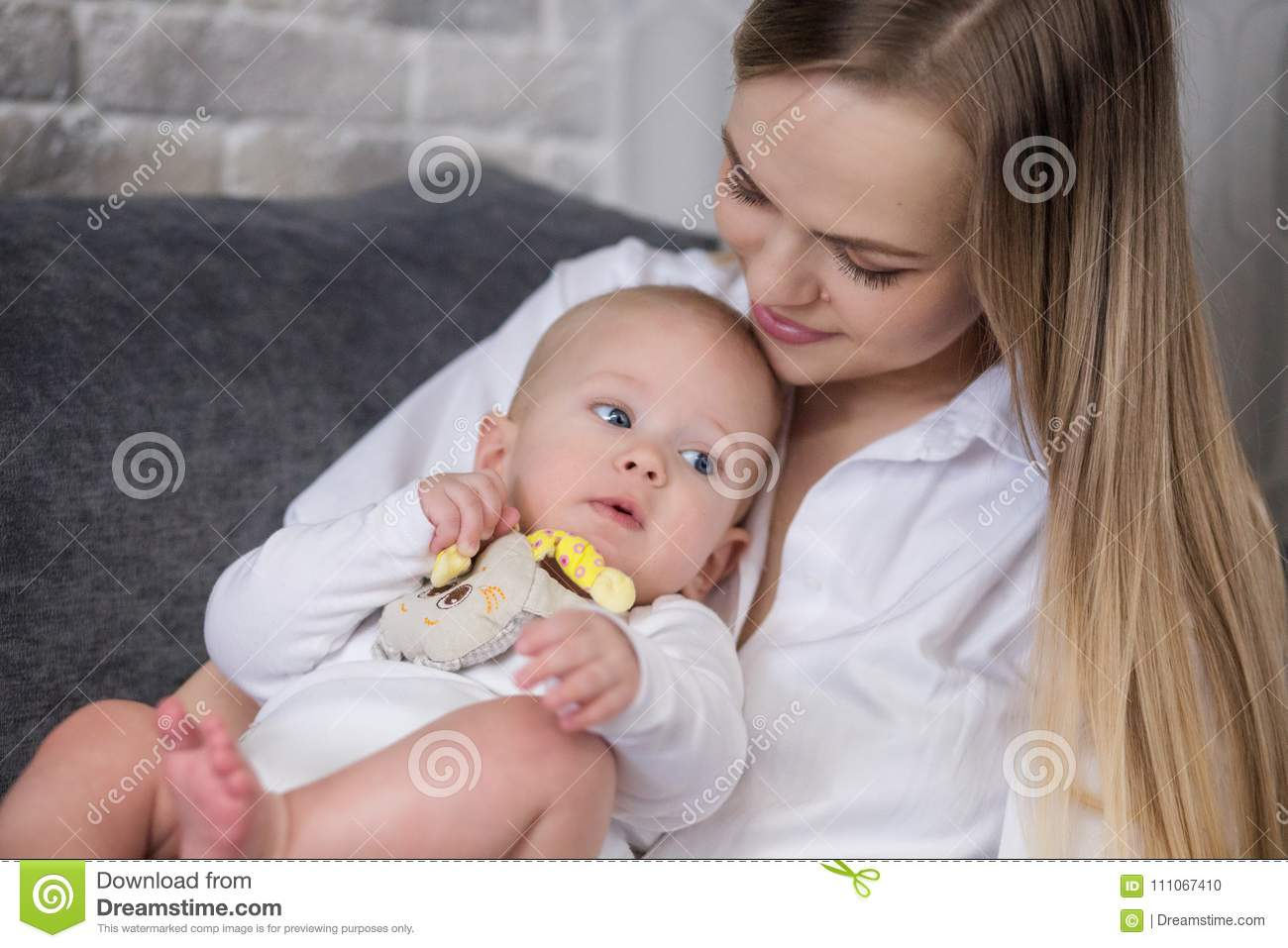 Mother and baby on the bed