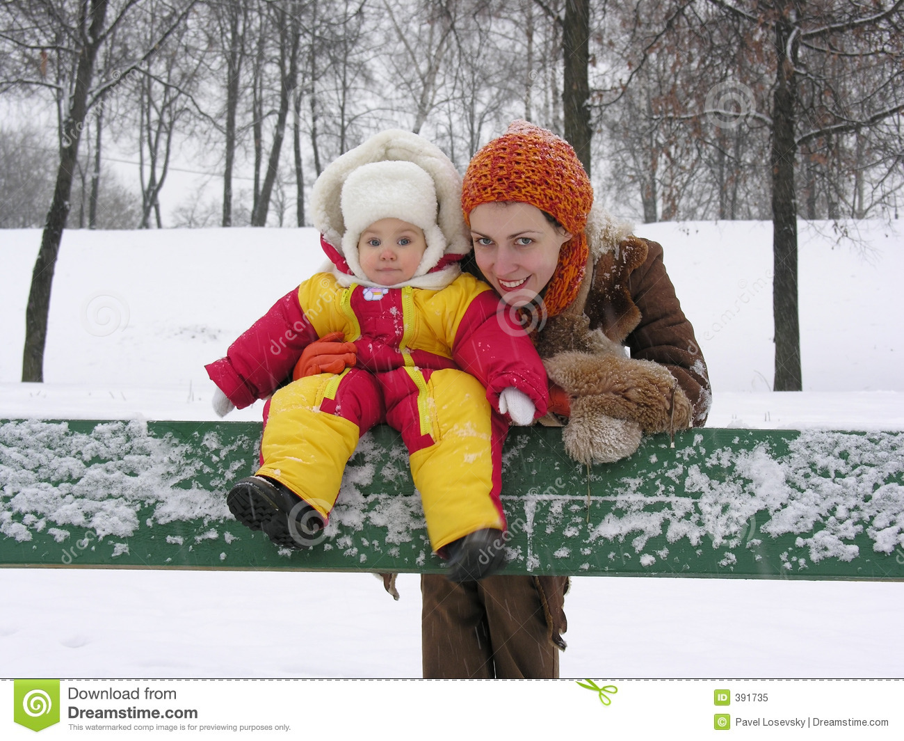 Mother with baby on bench. winter