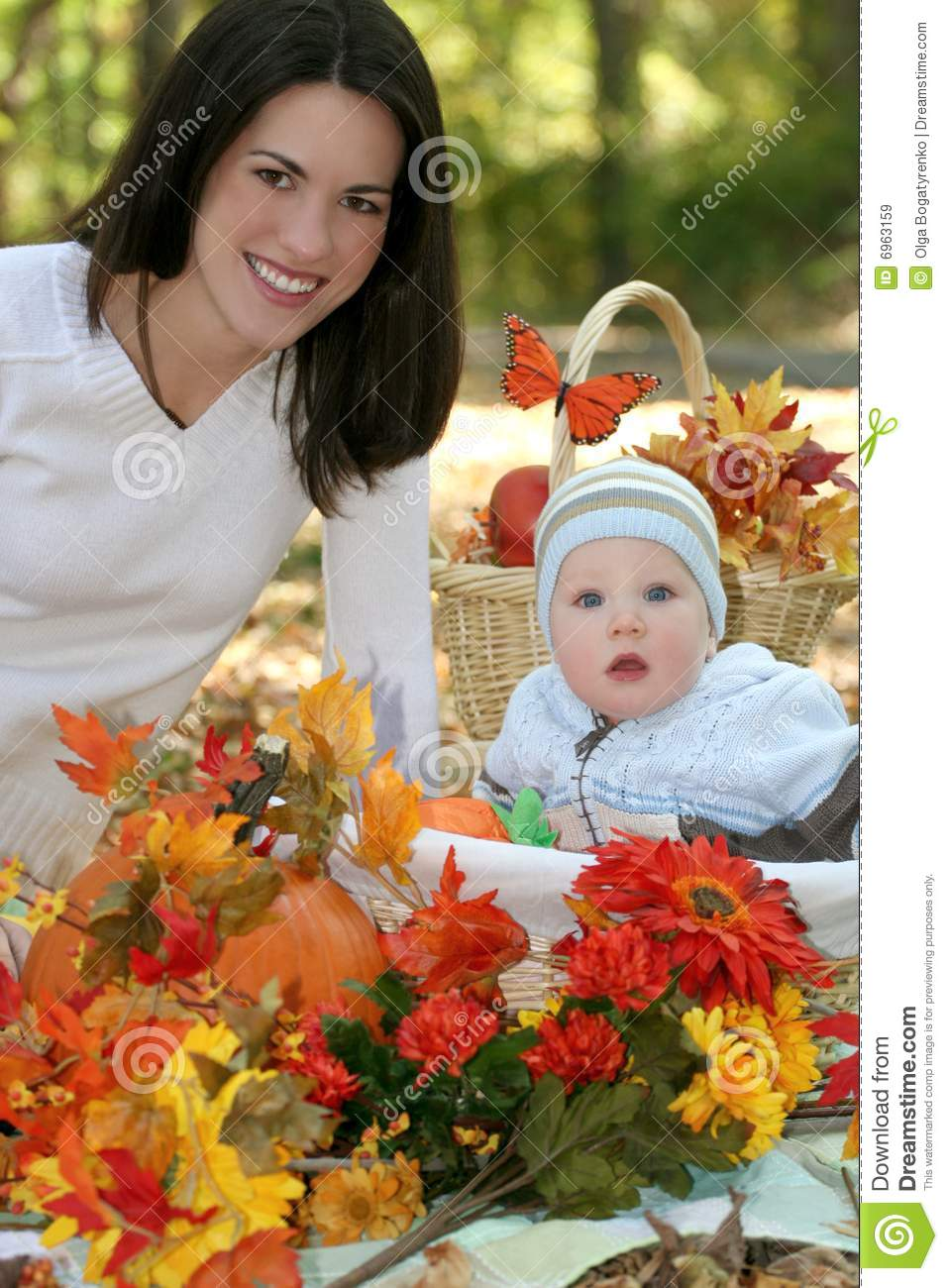 Mother And Baby Boy Fall Theme Royalty Free Stock Images