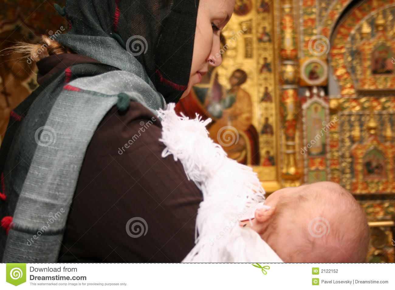 Mother with baby in church