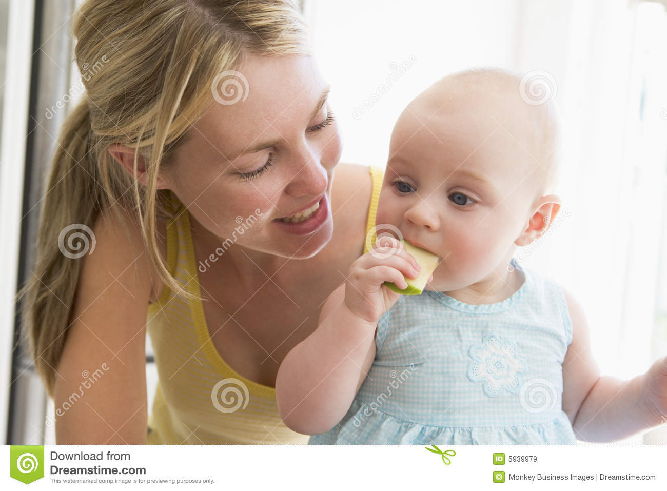 Mother and baby eating apple