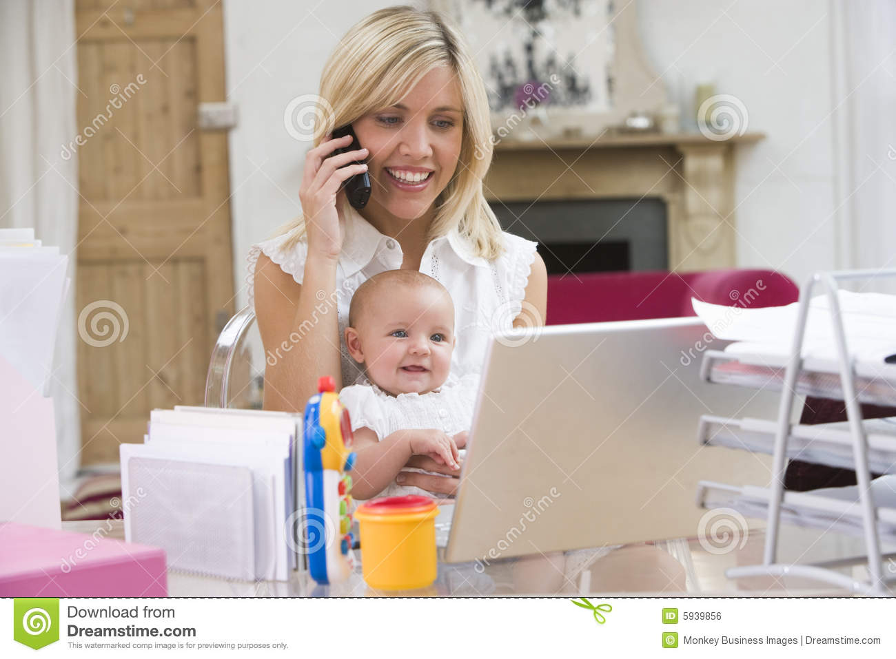 Mother And Baby In Home Office And Telephone Stock Photo
