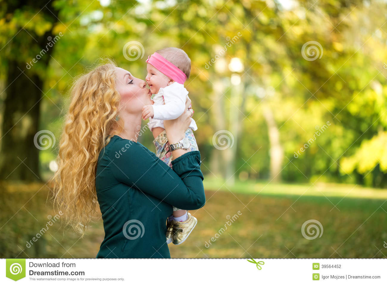Mother and baby kissing in nature outdoor stock photo for Cheerful nature