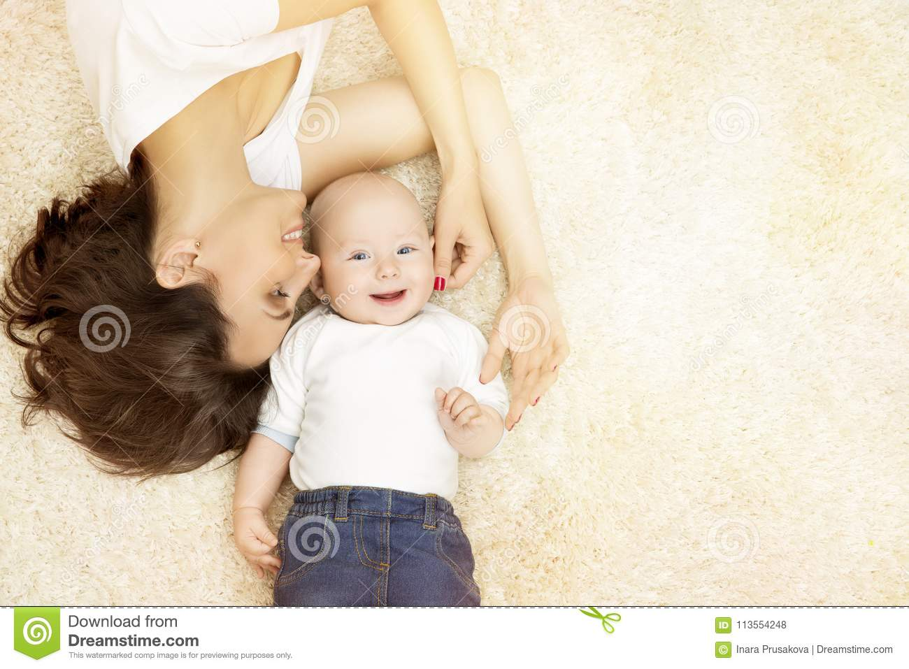 Mother and Baby lying on Carpet, Happy Family Portrait, Kid Boy