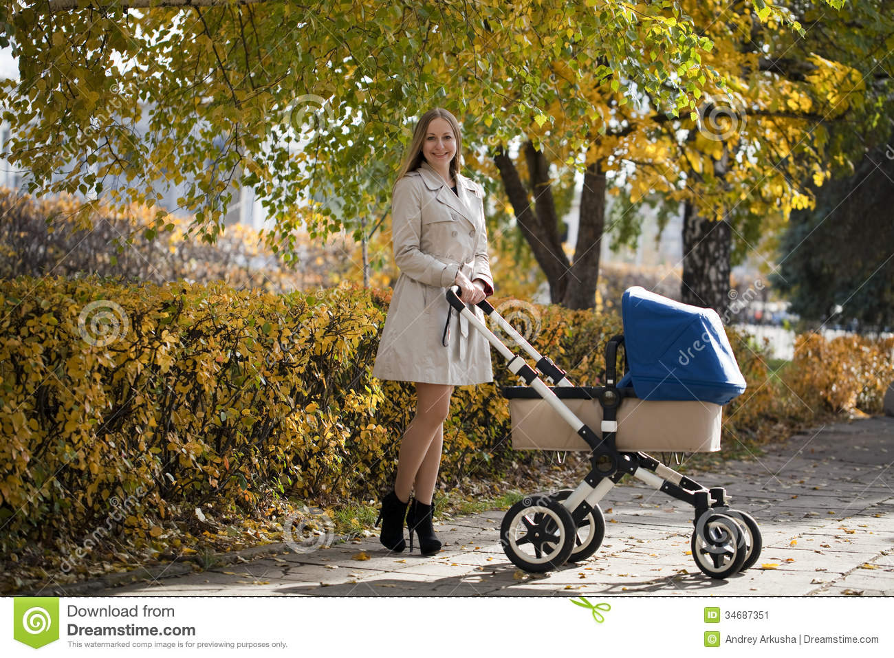 Mother With Baby Stroller For A Newborn Stock Image