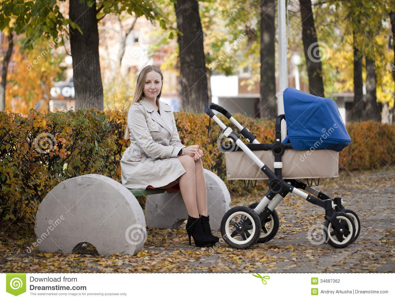 Mother With Baby Stroller For A Newborn Stock Photo