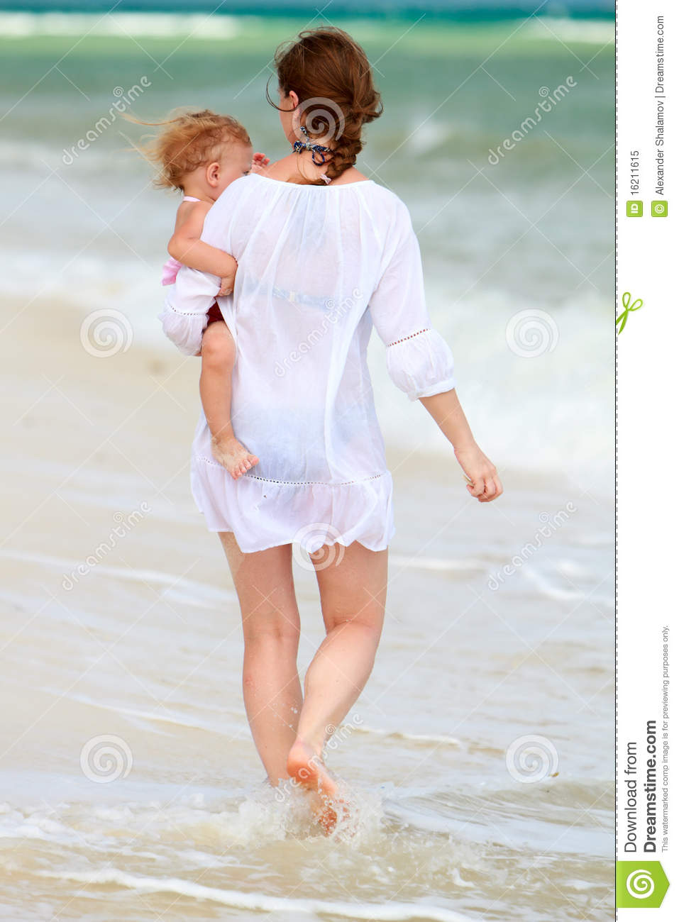 Pictures Of Mom And Baby Holding Hands Walking Upspring Wings Blue Mother Along Beach Royalty Free Stock
