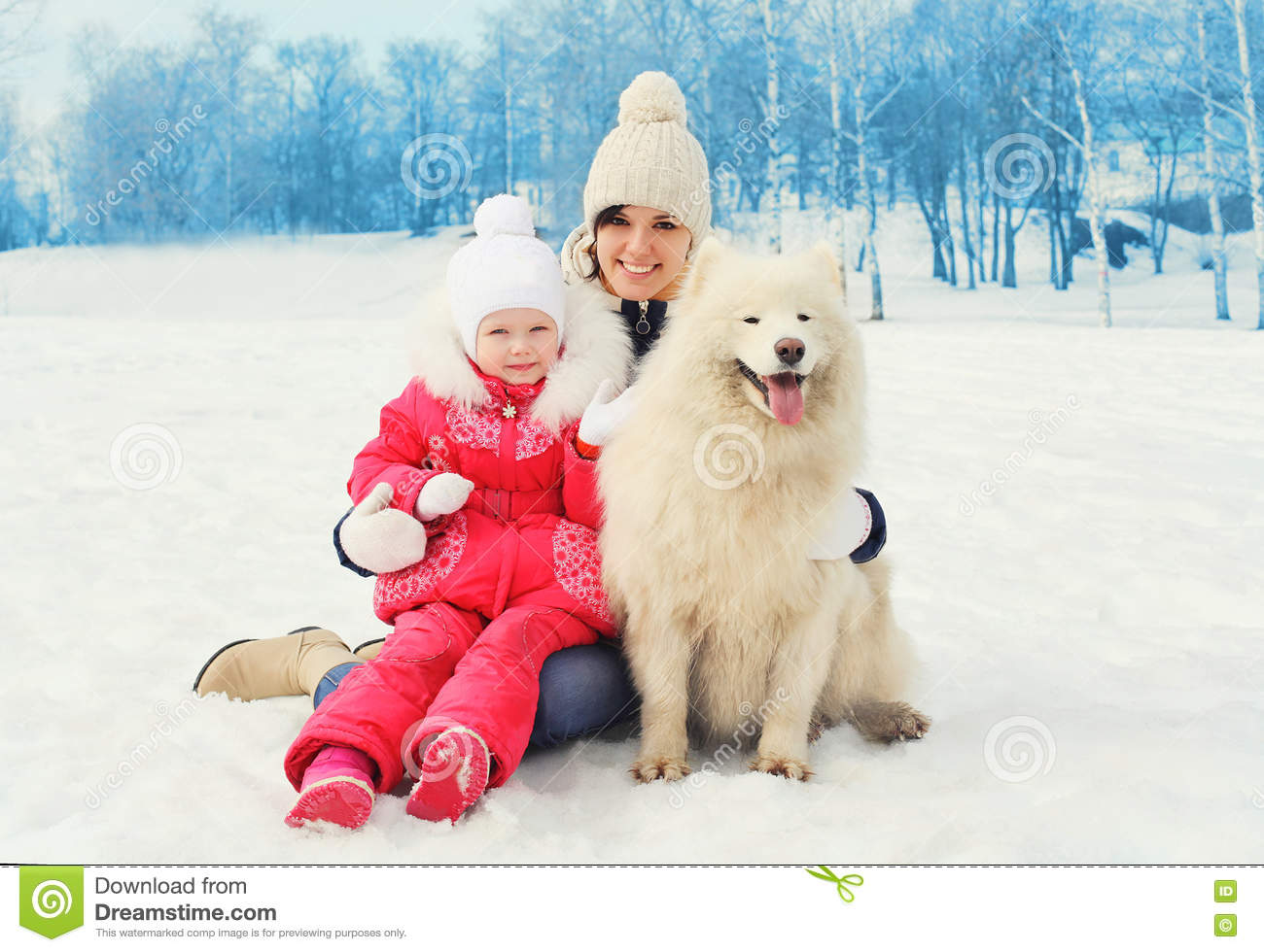 Mother and baby with white Samoyed dog together in winter