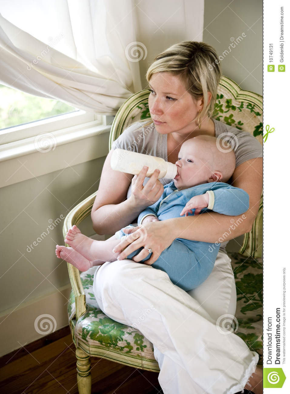 Mother Bottle Feeding Her Seven Month Old Baby Stock Image
