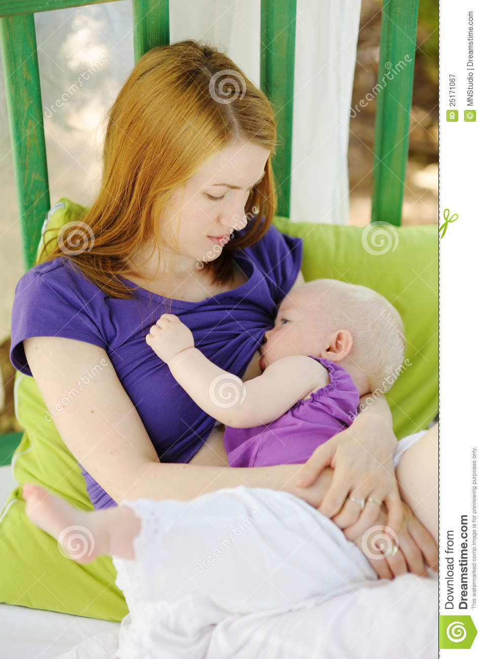 View Of Mother Breastfeeding Her Baby In Hospital Stock