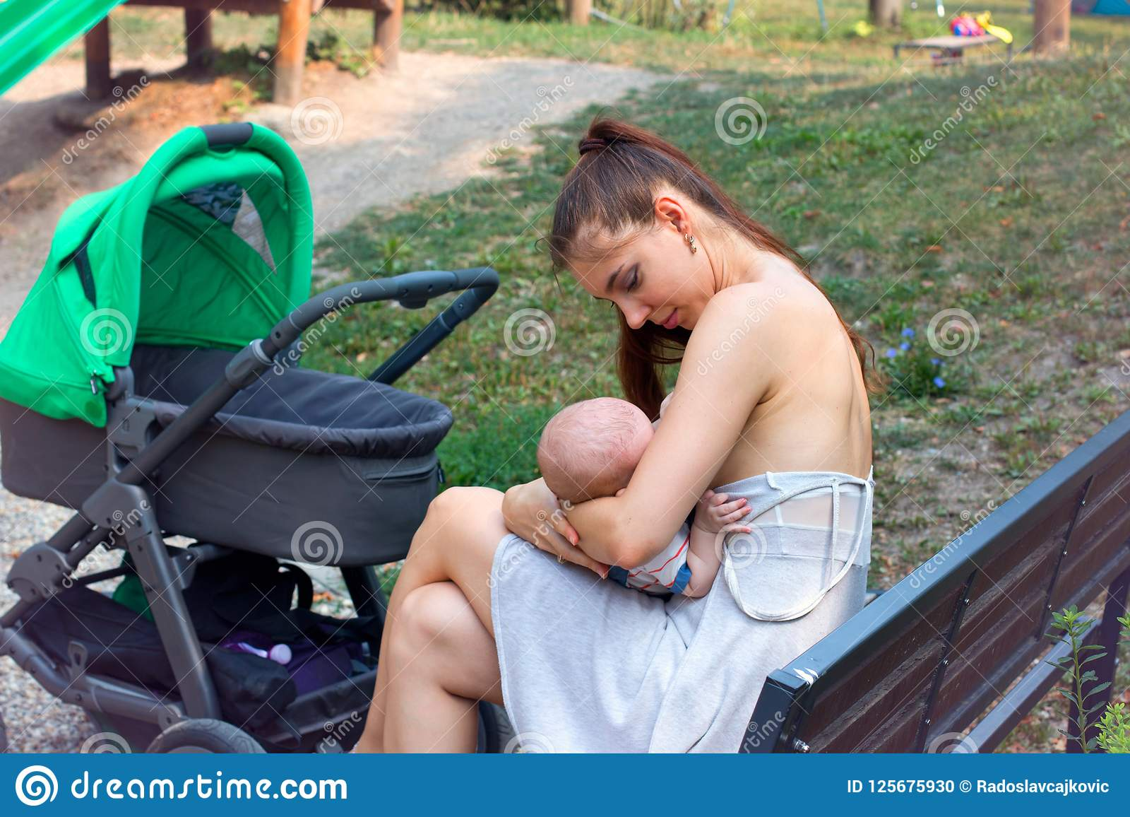 Astonishing Mother Caring Baby In Loving Arms Breastfeeding Baby In Ocoug Best Dining Table And Chair Ideas Images Ocougorg