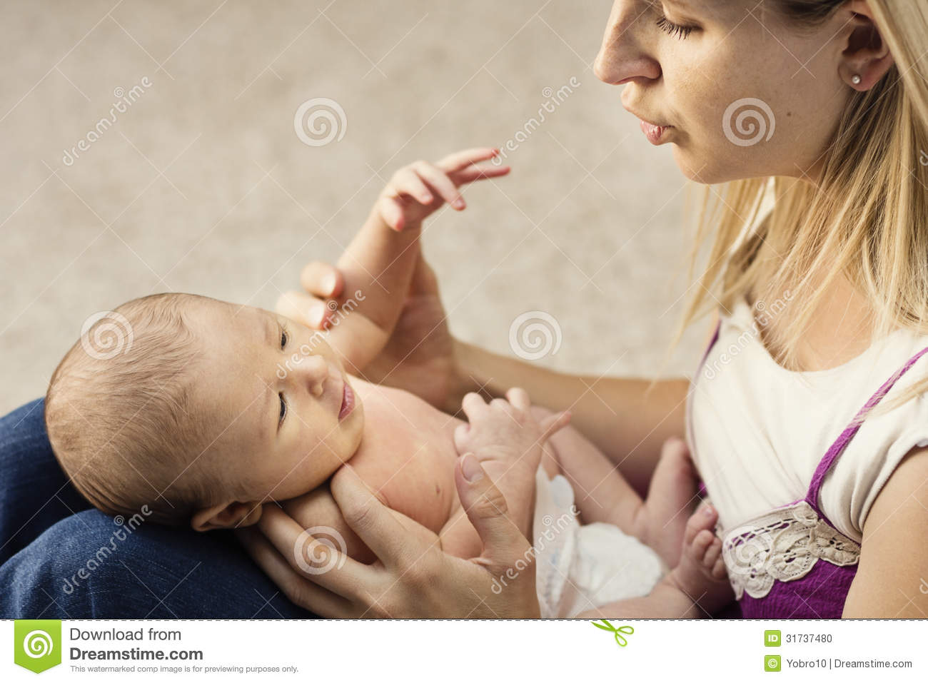 Mother caring for small baby