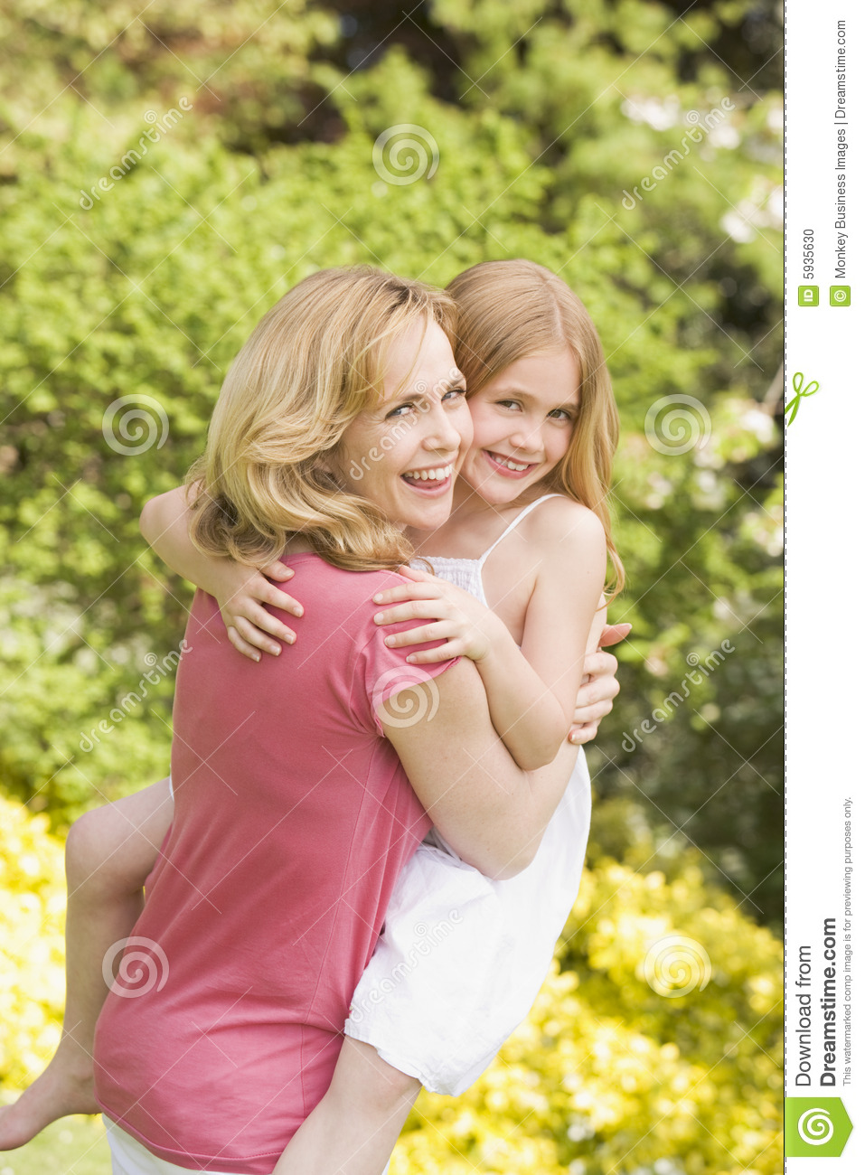 mother carrying daughter outdoors smiling stock photo mom and daughter clipart images mom and daughter cooking clipart