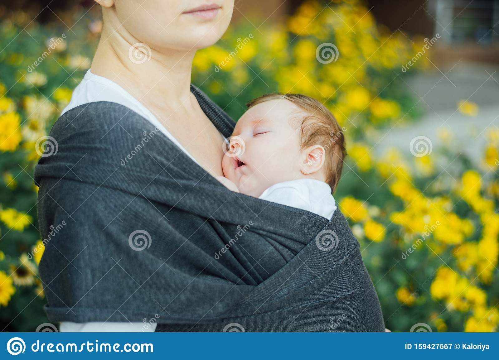 Young mother, holding her newborn baby boy - Blog