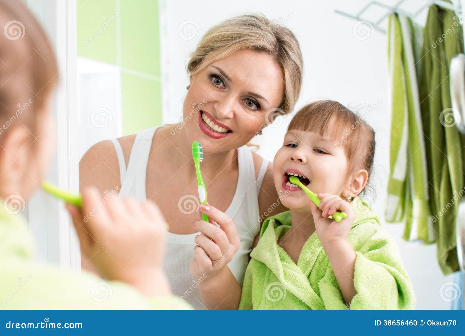 Kid Girl With Mom Washing In Bathroom Stock Photography