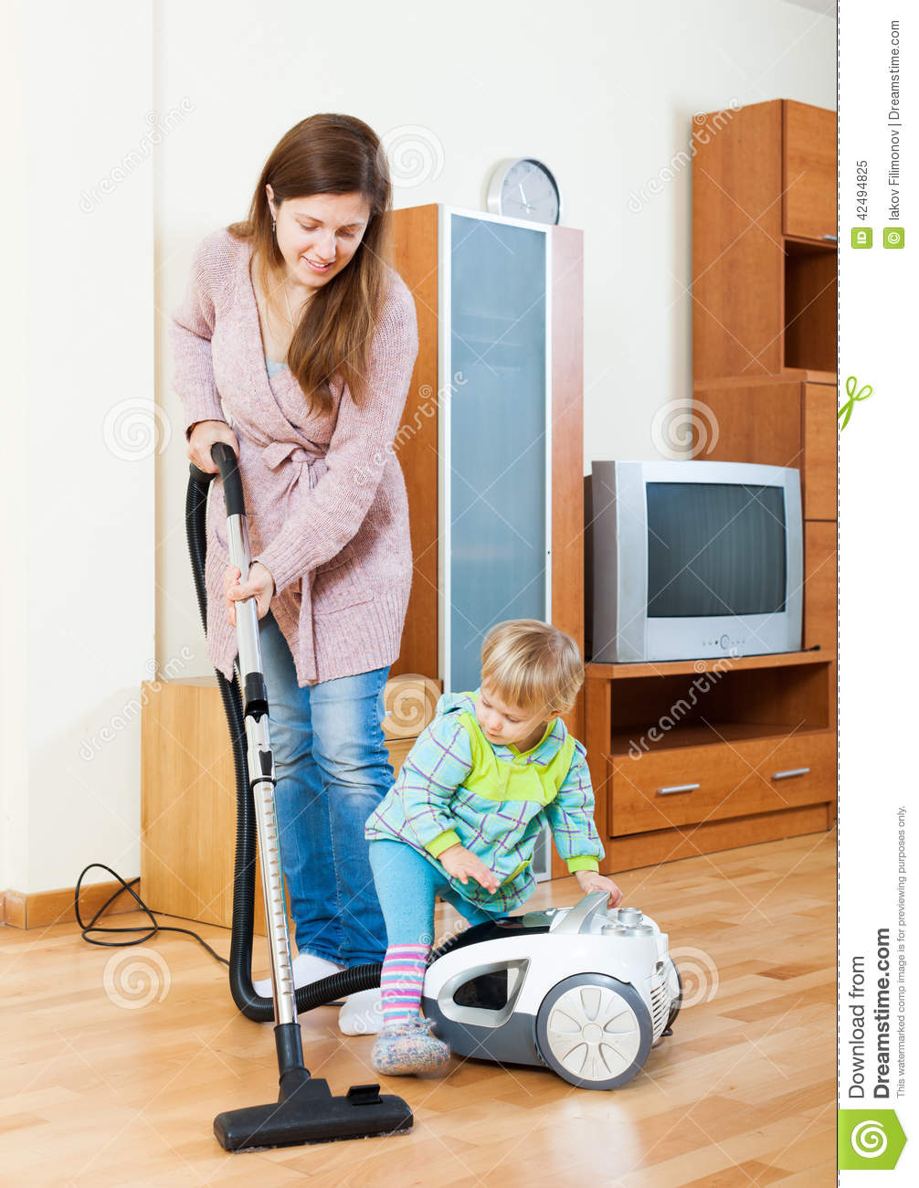 Girl Cleaning Living Room