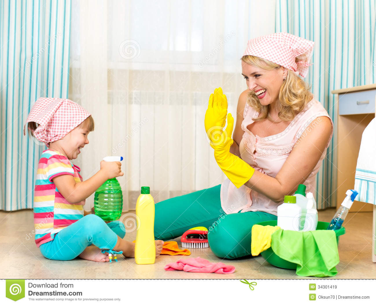 Mother With Child Cleaning Room And Having Fun Royalty