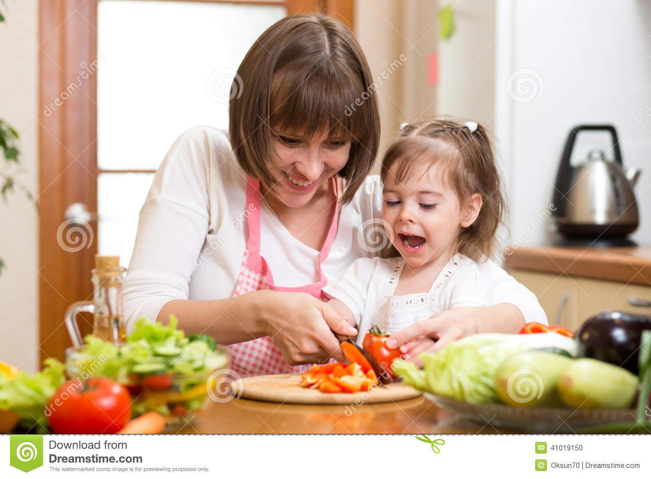 Mother And Child Cooking At Kitchen Stock Image