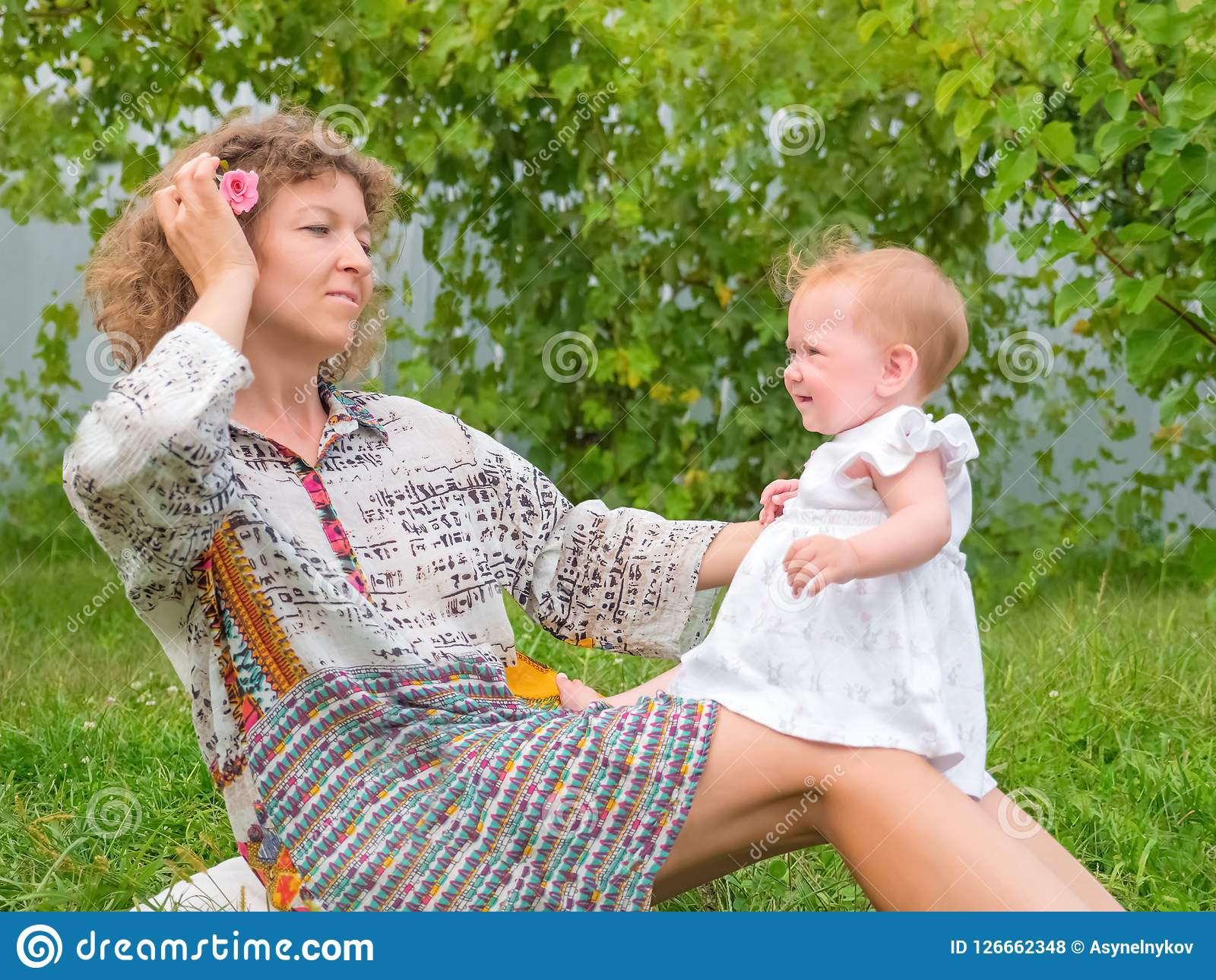 Mother and child. Happy parenting concept. Happy childhood background. Family background. Young mother playing with her child outdoor. Baby playing in the Royalty Free Stock Photos
