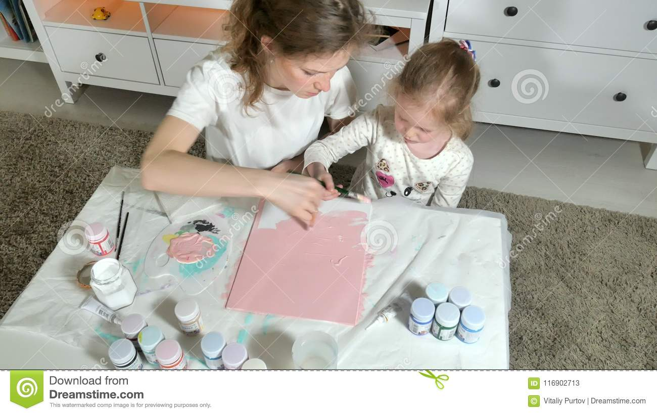Mother And Child Paint With Colored Fingers. Games With Children ...