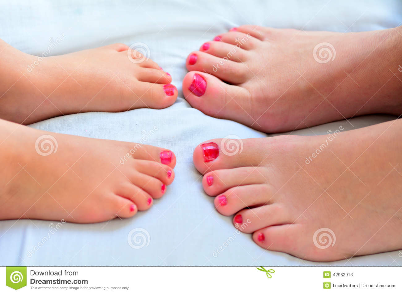 Mother And Child Paint Their Feet With Nail Polish Stock ...