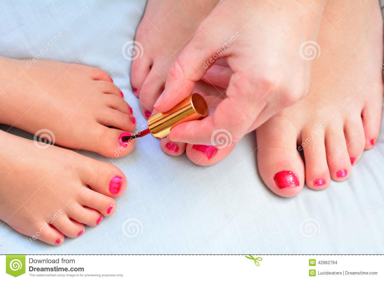 Mother and child paint their feet with nail polish stock for How to renew old nail polish