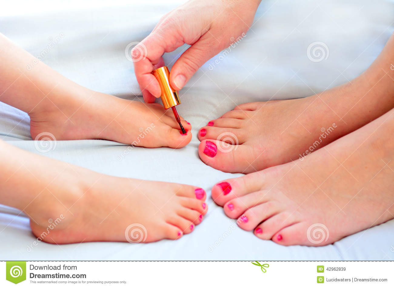 Mother And Child Paint Their Feet With Nail Polish Stock Image
