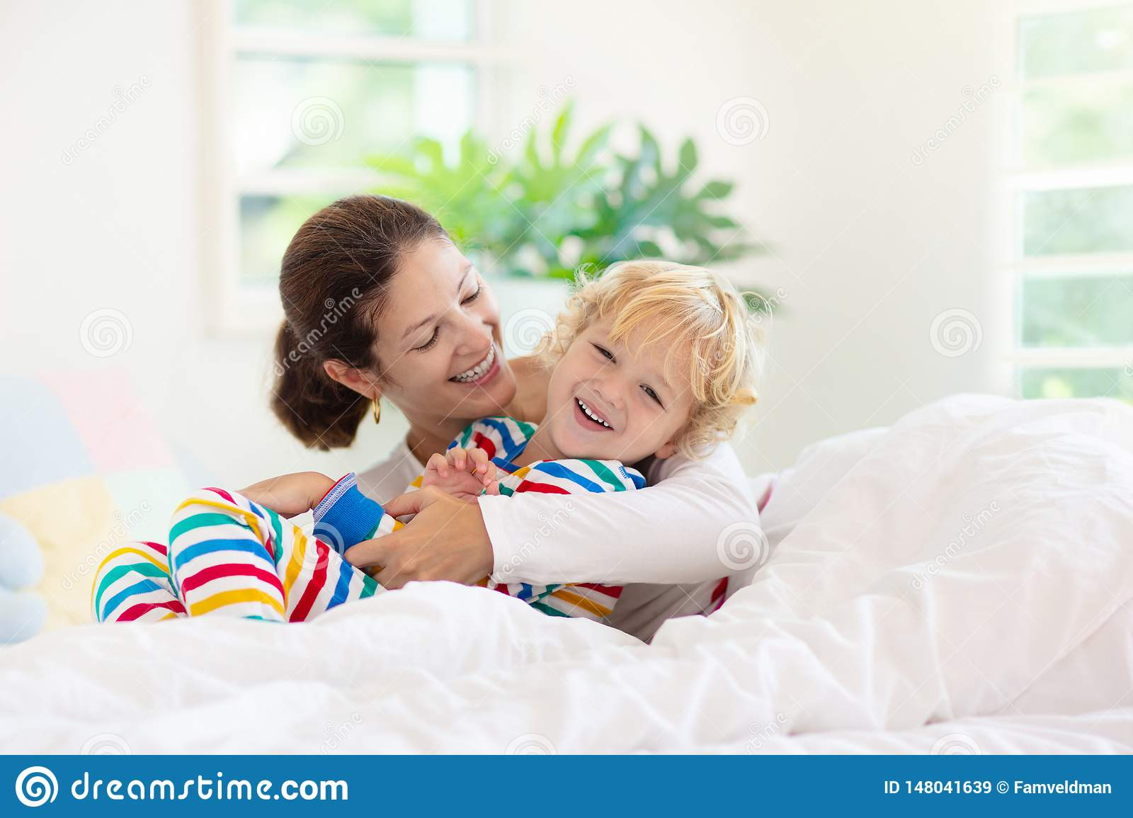 Mother and child in bed. Mom and baby at home