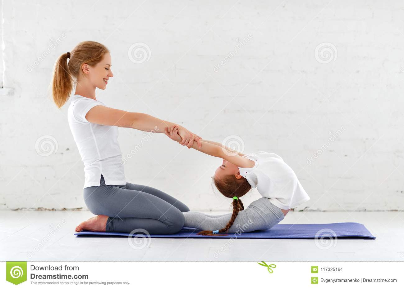 Mother With Child Practicing Yoga In Lotus Pose Stock ...