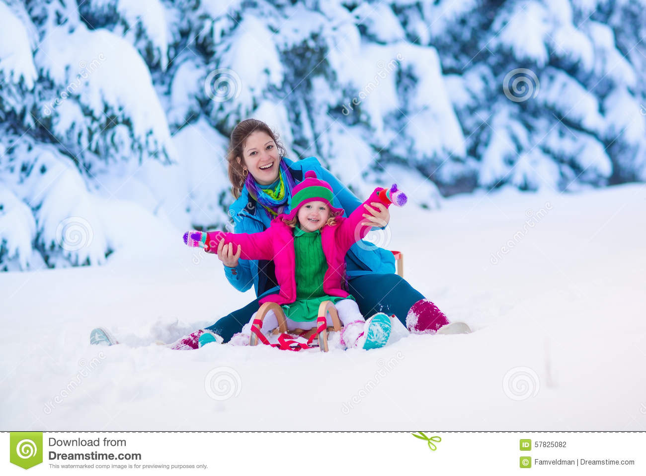 Mother And Child Sledding In A Snowy Park Stock Photo ...