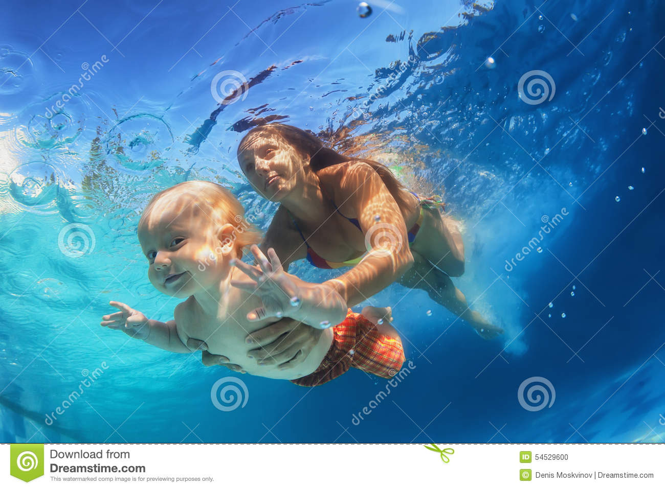 Download Mother With Child Swimming Underwater In The Pool Stock Photo - Image of attractive, background: 54529600