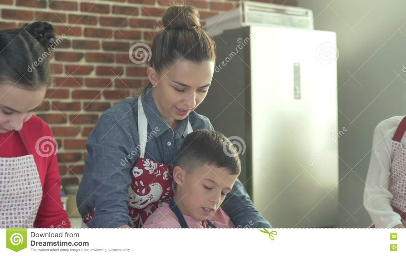 Mother With Children In Christmas Aprons Preparing Gingerbread Stock Footage Video Of Cooking Male 80992564