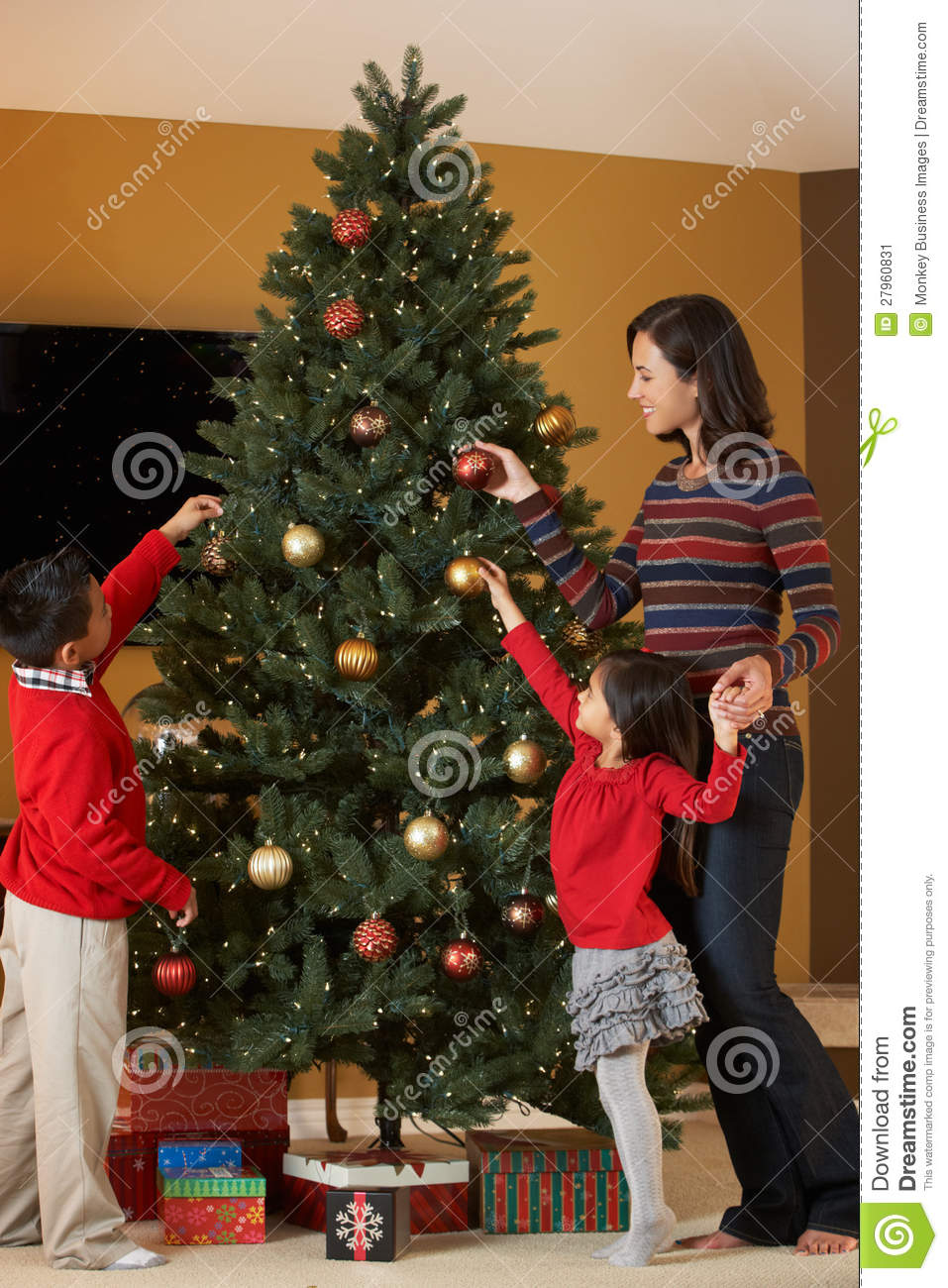 Mother And Children Decorating Christmas Tree Stock Image - Image ...
