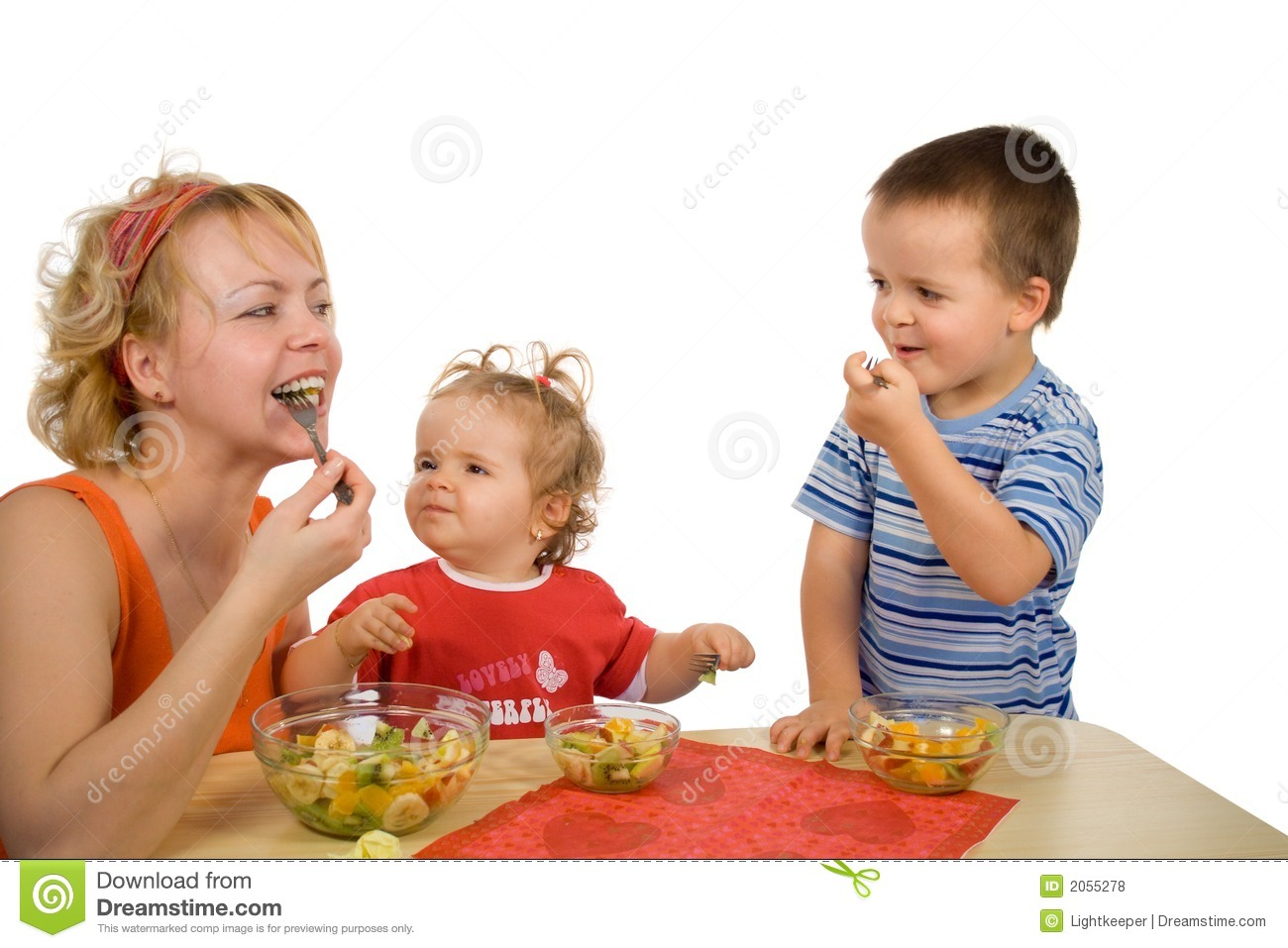 Mother And Children Eating Fruit Salad Royalty Free Stock