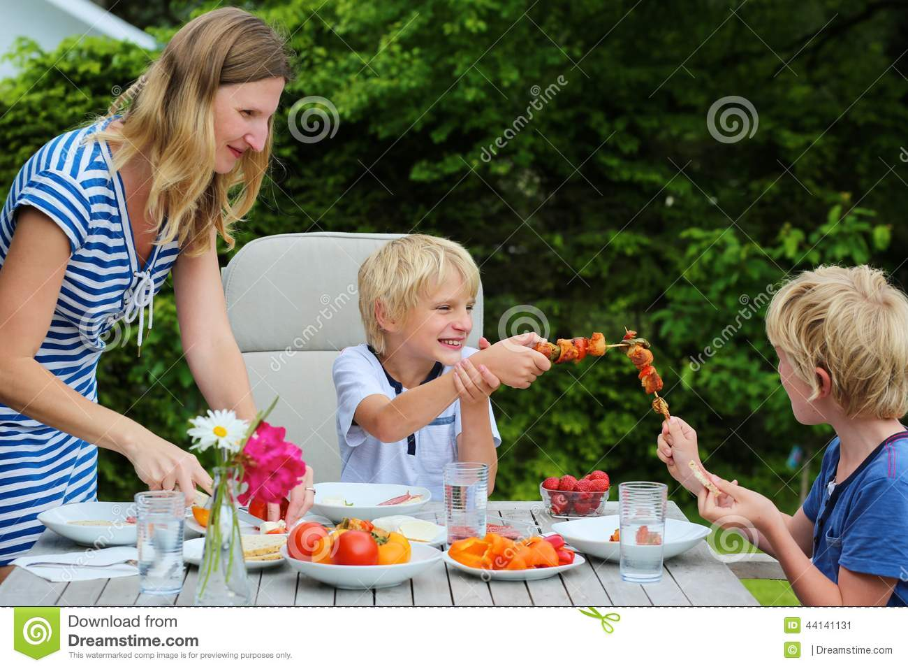 Mother with children eating outdoors stock image image 44141131 - Houses for families withchild ...
