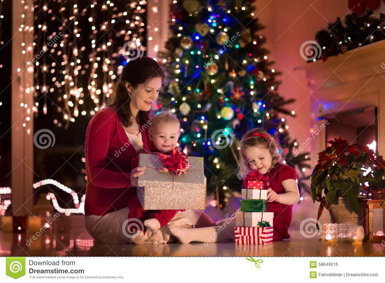 Mother And Children At Home On Christmas Eve Stock Photo - Image ...