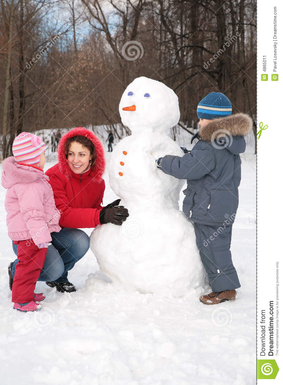 mother and children make snowman stock image image 4865011