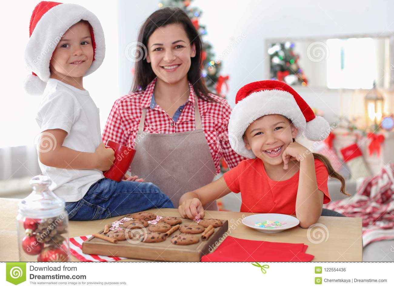 mother and children making christmas cookies together - Making Christmas Cookies