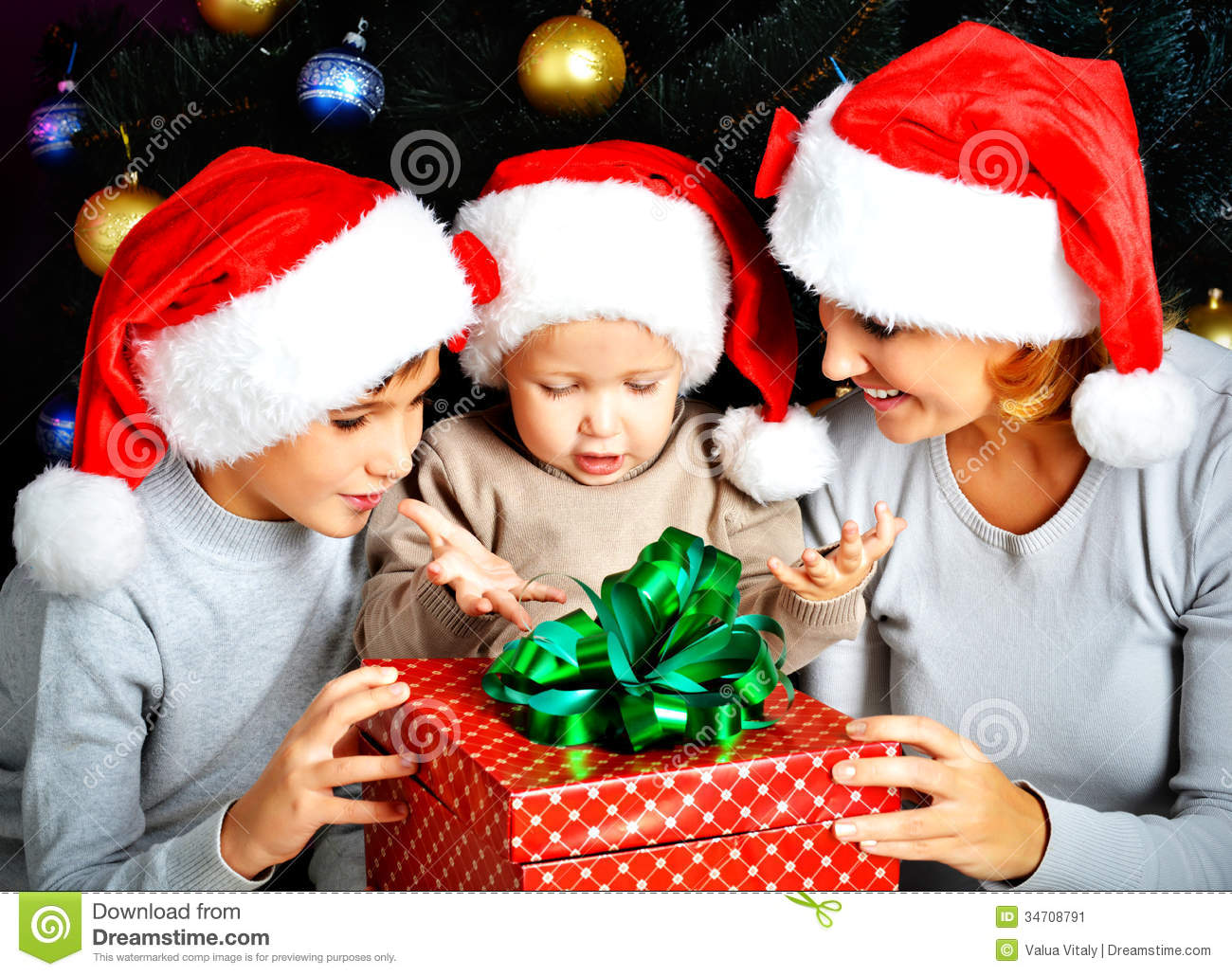 Mother And Children With New Year Gift On The Christmas ...